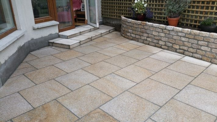 Brown Granite Patio with Raised Granite Flowerbed
