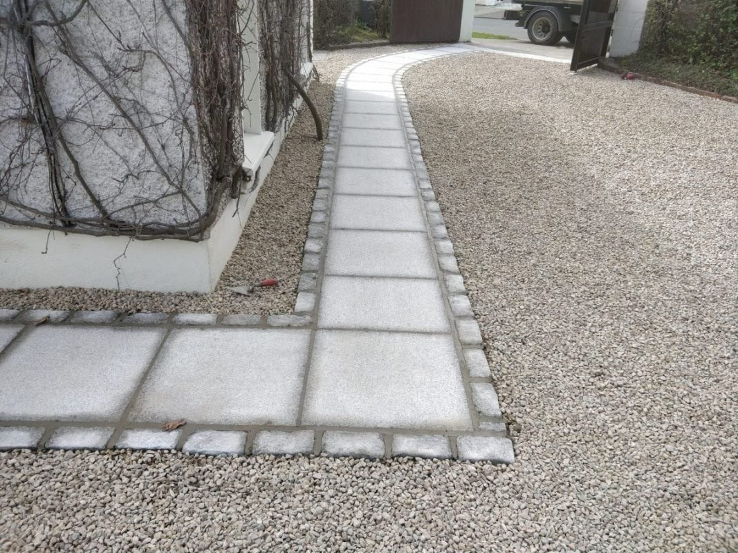 Gravel Driveway accompanied by Granite Path with Trim